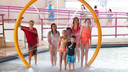 Group of children inside Water-Zoo indoor water park in Clinton, Oklahoma