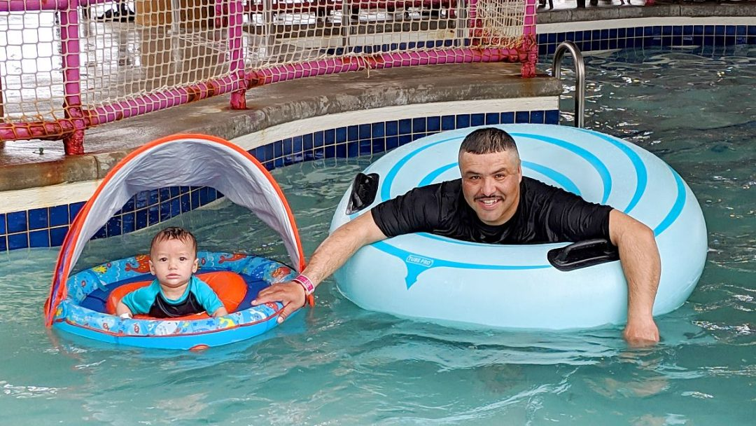Father and toddler in the Lazy River at Water-Zoo Indoor Water Park